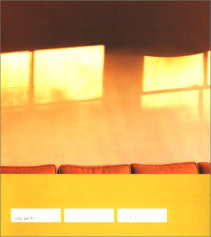"""Exhibition catalogue cover for 2000 Uta Barth exhibition """"...and of time"""". Shadow of window panes on yellow wall above the tops of square orange cushions. Text on white rectangles on yellow background: Uta Barth, and in time"""