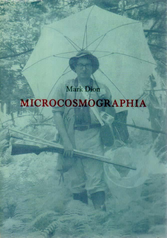 "Exhibition catalogue cover. A blue-tinted photo of the artist, a man in glasses wearing safari gear and carrying and umbrella and hunting rifle, walks through brush. Title text: ""Mark Dion, Microcosmographia"""