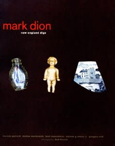"Exhibition catalogue cover. A tiny glass vial, an ivory figuring of a child, and a fragment of blue-and-white china on a dark background. Title text: ""mark dion, new england digs"""