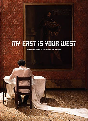 "Exhibition catalogue book cover: Person in white robes sits in a chair facing an baroque painting on an ornate red wallpapered wall. Title text: ""MY EAST IS YOUR WEST"""