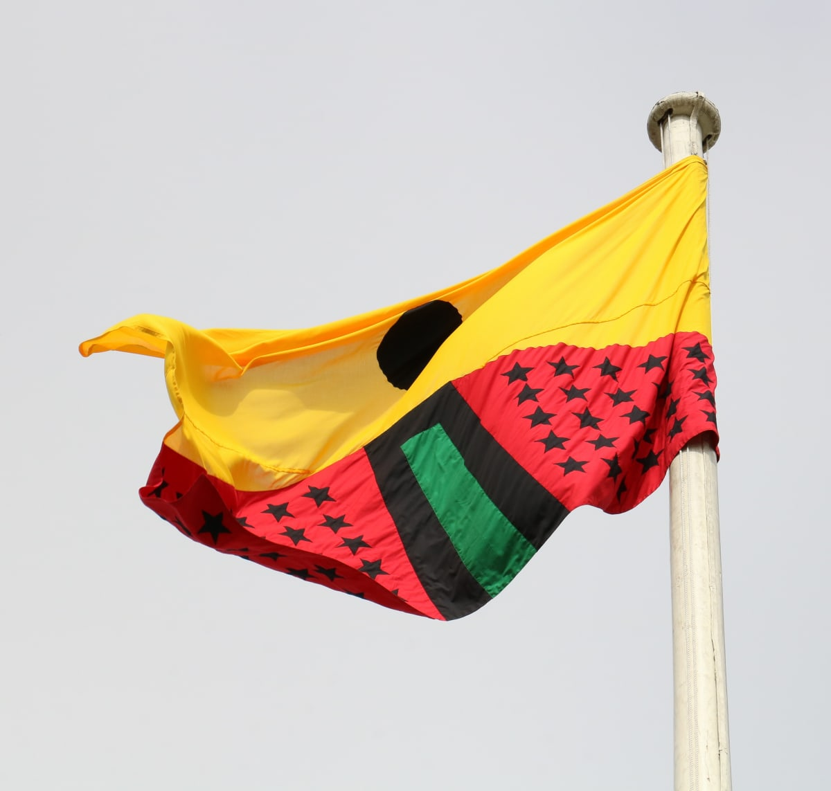 Larry Achiampong PAN AFRICAN FLAG FOR THE RELIC TRAVELLERS' ALLIANCE, 2017 Appliqué Flag 200 x 300 cm Courtesy of the artist. Commissioned by Somerset House.