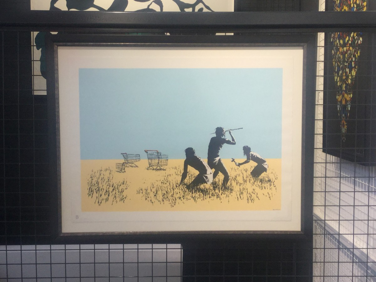 "<span class=""link fancybox-details-link""><a href=""/artists/27-banksy/works/844/"">View Detail Page</a></span><div class=""artist""><strong>Banksy</strong></div> <div class=""title""><em>Trolley Hunters (coloured) *SOLD*</em>, 2007</div> <div class=""medium"">Screenprint, signed and numbered in pencil</div> <div class=""dimensions"">50cm x 70cm</div> <div class=""edition_details"">Edition of 750</div>"