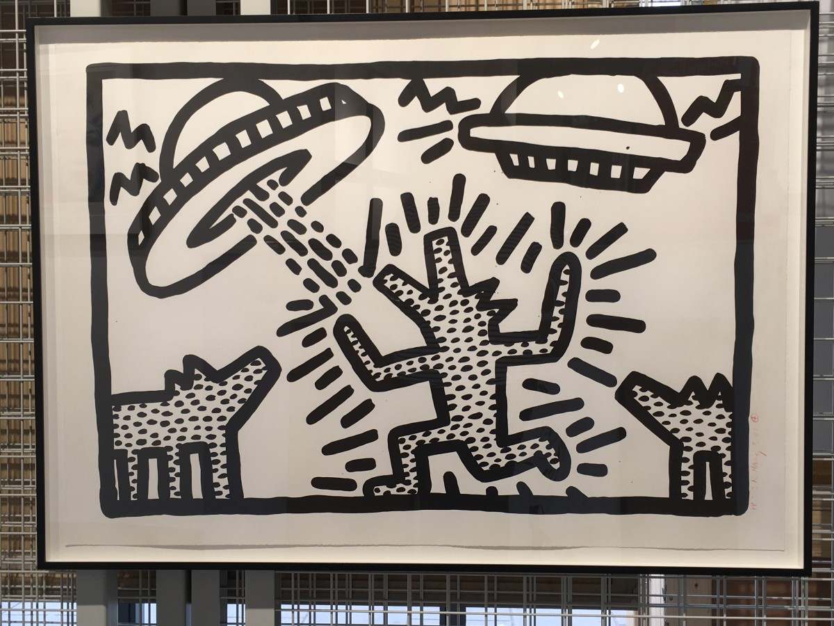 """<span class=""""link fancybox-details-link""""><a href=""""/artists/30-keith-haring/works/847/"""">View Detail Page</a></span><div class=""""artist""""><strong>Keith Haring</strong></div> <div class=""""title""""><em>Untitled (Flying Saucers with Dogs) *SOLD*</em>, 1982</div> <div class=""""medium"""">Lithograph, signed, numbered and dated in red crayon</div> <div class=""""dimensions"""">61 x 91.4 cm<br /> 24 x 36 in</div> <div class=""""edition_details"""">Edition of 40 plus proofs</div>"""