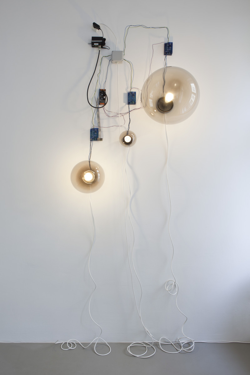 Angela Bulloch Smoke Three Speed, 2009 Transparent spheres, lamps, lampholders, cable, DMX controller, dimming mechanisms Installation dimensions variable Edition of 5