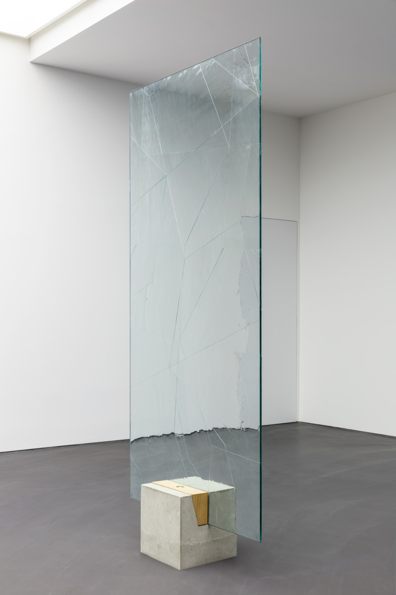 Daniel Steegmann Mangrané Systemic Grid 124 (Window), 2019 Security glass, ornamental glass, mounts, concrete and wood pedestal, glass panel 261 x 126 x 1,5 cm (102 3/4 x 49 5/8 x 3/8 in) (glass panel) 40 x 40 x 40 cm (15 3/4 x 15 3/4 x 15 3/4 in) (concrete base) 278,2 x 126 x 40 cm (109 1/2 x 49 5/8 x 15 3/4 in) approx. (overall)