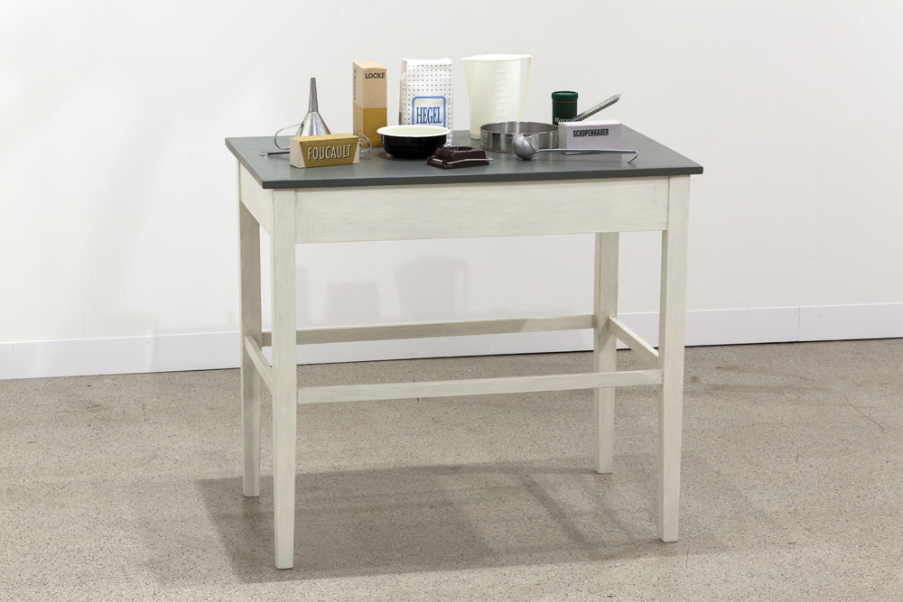 Roman Ondak Sated Table, 1997 Silkscreen print on cardboard, kitchen utensils, wooden table 100 x 92 x 59 cm
