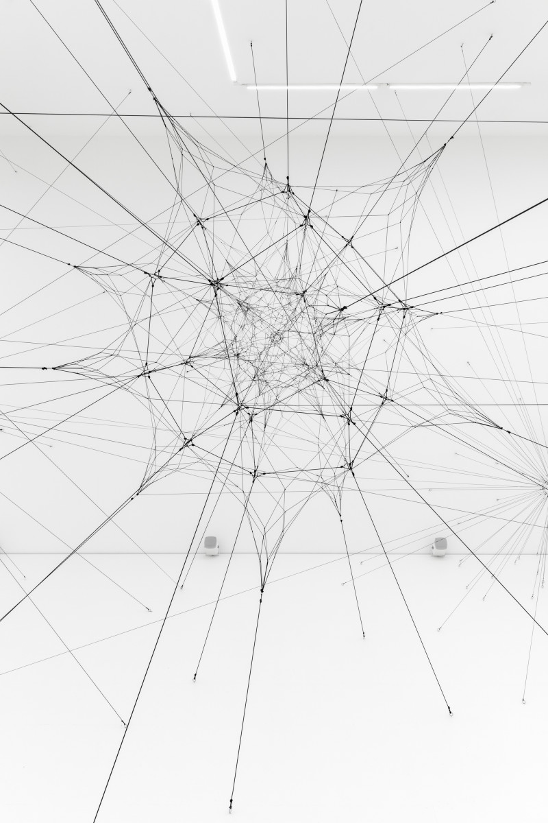 Tomás Saraceno 0.61 GHz (RXCJ2003.5-2323 / Radio Halo), 2019 Rope, contact microphones, hardware, passive speakers, amplifiers, shakers, subwoofers ø 220 cm (86 5/8 in), 32 spokes Onsite installation dimensions variable