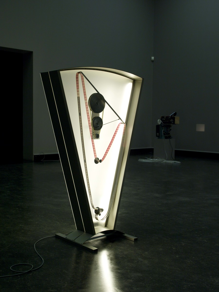 Rosa Barba Color Clock (red): Verticals Lean Occasionally Consistently Away from Viewpoints, 2012 35 mm film, motor, aluminum, Plexiglas Edition of 3