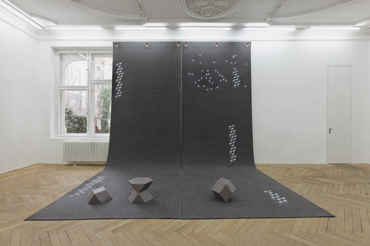 Angela Bulloch Hercules Wall Hanging 008, 2014 Two printed grey felt panels with 6 rivets and 6 hanging pegs, LED lights, 3 oiled grey MDF sculptures 600 x 200 cm each, 2 parts (felt panels) 600 x 400 cm overall (installation)