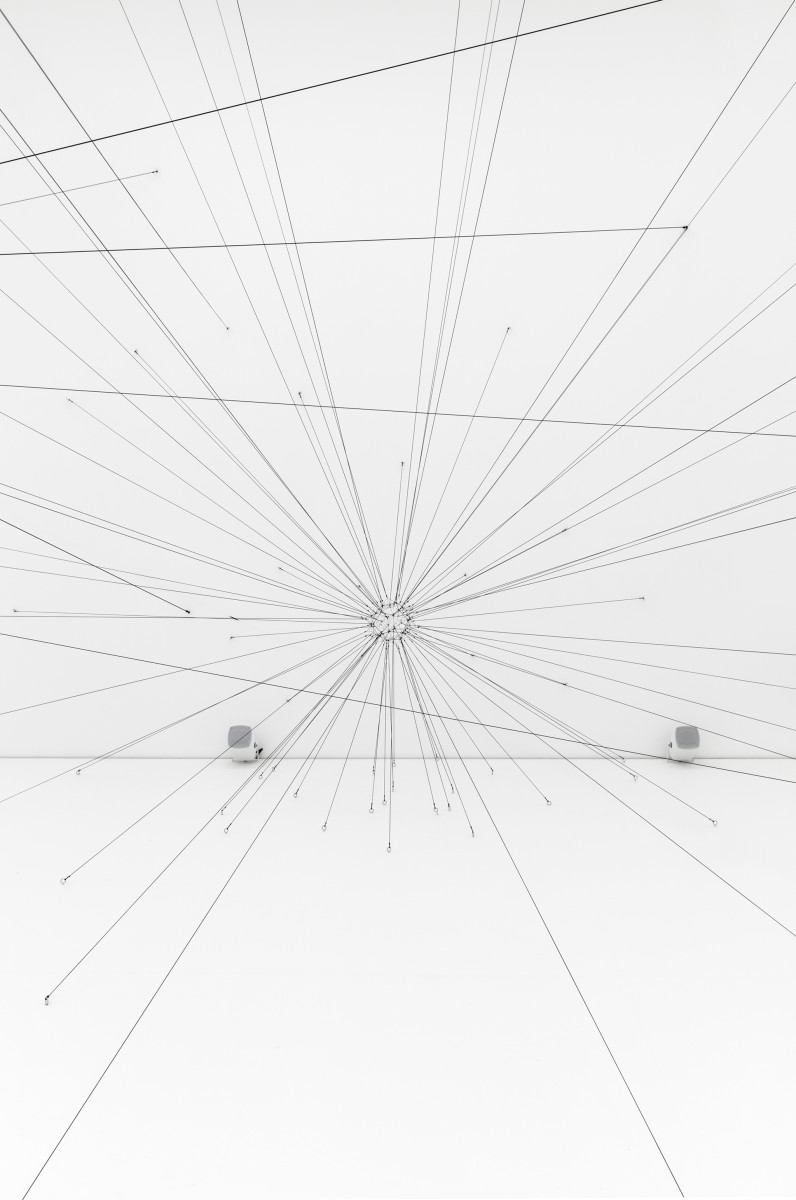 Tomás Saraceno 58 - 178 Hz (Argiope keyserlingi Courtship / Emitted Frequency), 2019 Rope, contact microphones, hardware, passive speakers, amplifiers, shakers, subwoofers ø 15 cm (5 7/8 in), 80 spokes Onsite installation dimensions variable