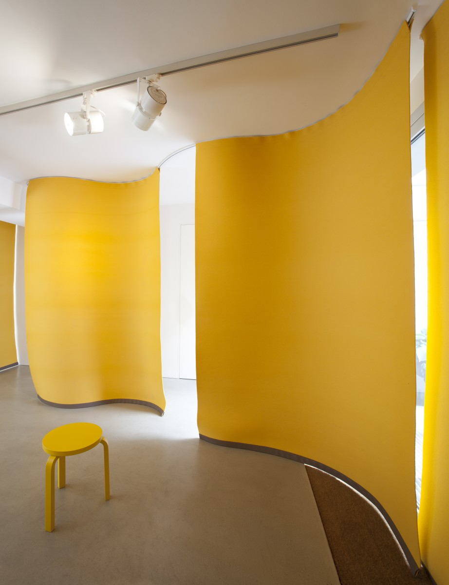 Detail: Angela Bulloch, Yellow Music Station – Extra Large, 2012, six yellow felt curtains, yellow Alvar Aalto Stool, wall mounted table, sound system, wall mount, 180 cm width each, 6 part (curtain). Photo © Andrea Rossetti