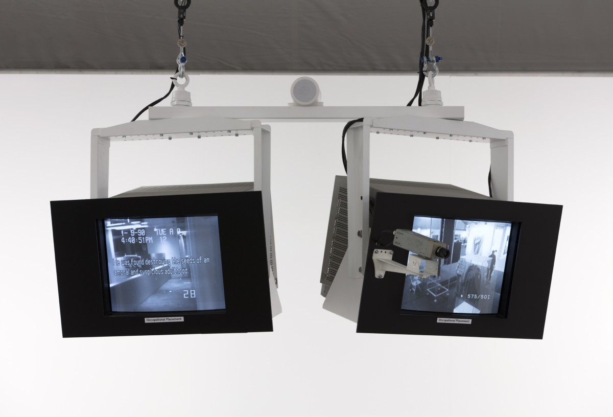 Julia Scher, Occupational Placement, 1989-90, monitors, hanging system, monitor brackets, monitor masks, surveillance camera, camera bracket, video switcher, media players, SD cards, cables and connectors, loudspeaker, multi-channel digital video (color and black and white, silent) and real-time video stream (black and white, silent), sound installation, installation dimensions. Photo © Andrea Rossetti