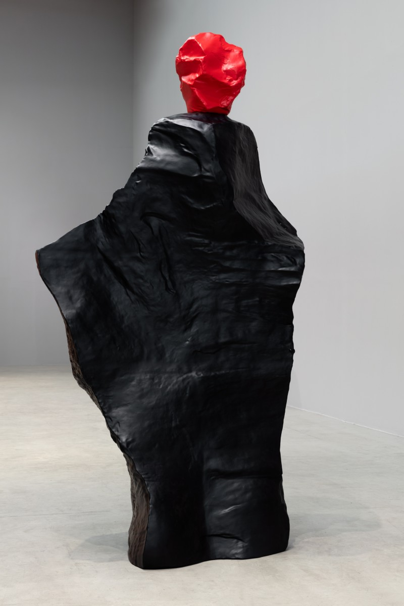 Ugo Rondinone, red black monk, 2020, painted cast bronze, unique, 300 x 162 x 108 cm (118 1/8 x 63 3/4 x 42 1/2 in). Photo © Andrea Rossetti