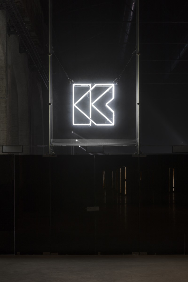 Ari Benjamin Meyers, K Club, 2019, performance, environment, neon sign, 2 12-inch LP vinyl records, installation dimensions variable. Exhibition view: In Concert, OGR, Turin, 2019. Photo © Andrea Rossetti