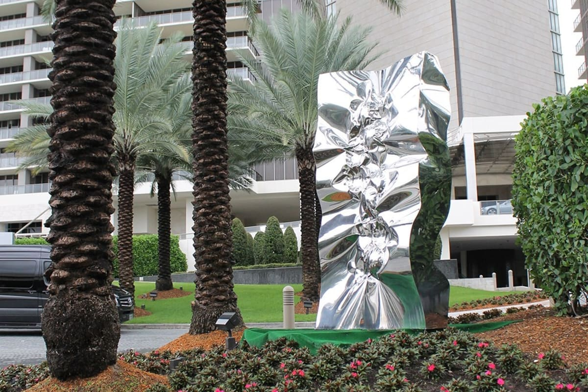 """Thunder Light"" mirror-polished stainless steel sculpture by artist Helidon Xhixha"