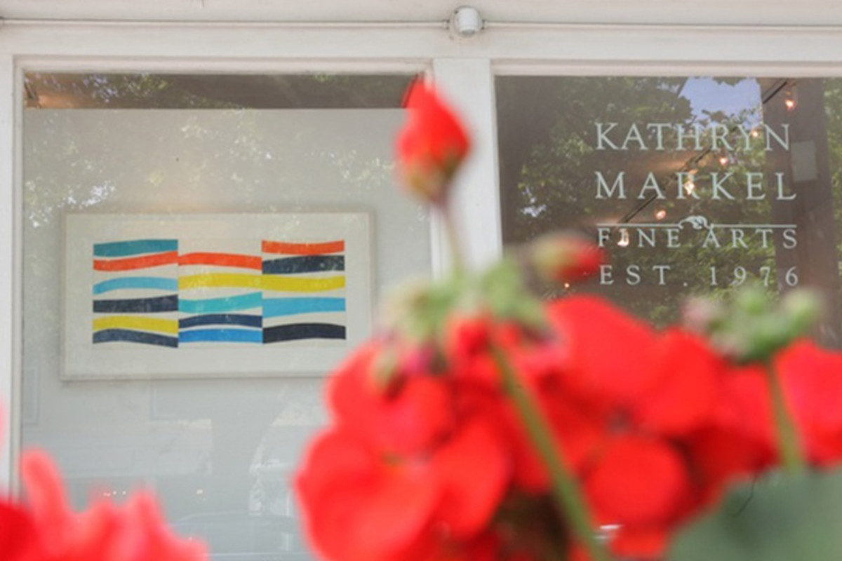 A photograph of Kathryn Markel Fine Arts' Bridgehampton location with a watercolor painting by Kim Uchiyama on display. It was shot behind red roses.