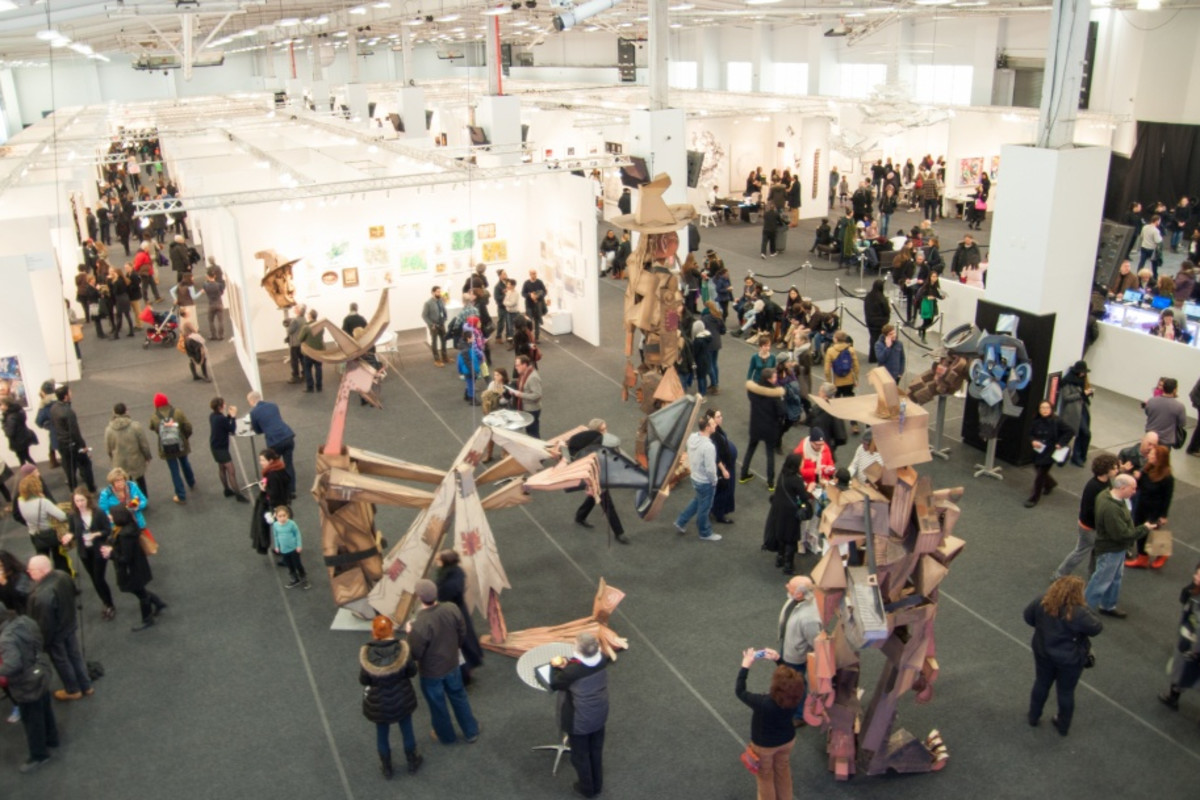 Photograph of an art convention showcase.