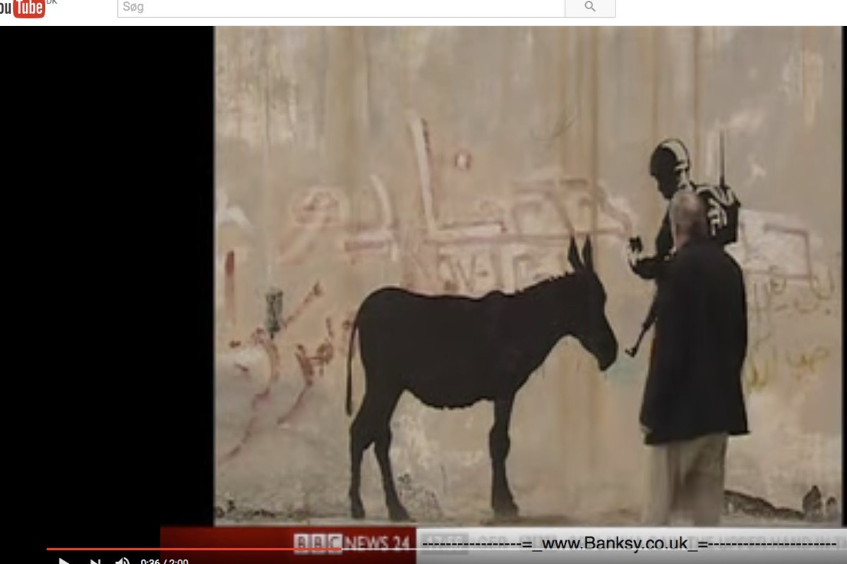 Rare footage from bethlehem where Banksy is interviewed on the works he did there in 2007.
