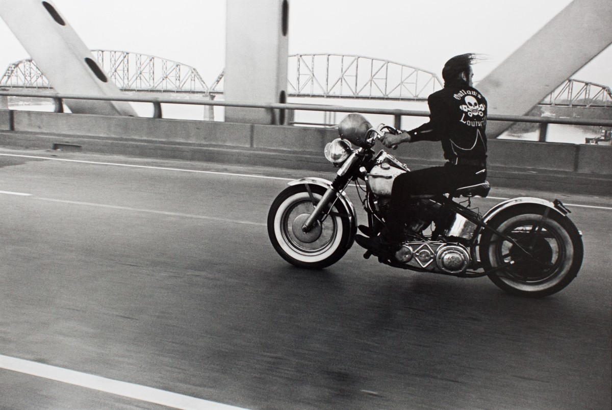 "<div class=""artist""><strong>Danny Lyon</strong></div><div class=""title_and_year""><em>Crossing the Ohio River, from The Bikeriders, 1966</em>, 2010</div><div class=""medium"">Silver gelatin print, printed later</div><div class=""dimensions"">Paper Size: 40.4 x 50.4 cm</div><div class=""signed_and_dated"">Signed, titled and dated in pencil on verso. Printer wetstamp in red ink on verso</div>"
