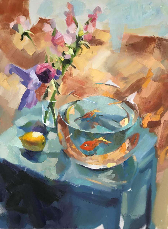 Goldfish bowl on blue table