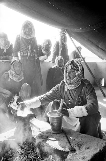 """George Rodger, Camel Corps. """"Gahawa Morah"""" – a Real Cup of Coffee is made by men of the Camel Corps on patrol in the deserts of the Hashemite Kingdom of Jordan, 1952."""
