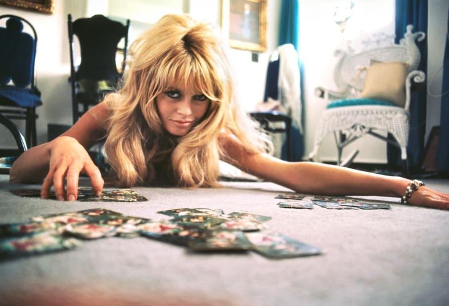 """Douglas Kirkland, Brigitte Bardot plays cards on the set of """"Viva Maria"""", 1965"""