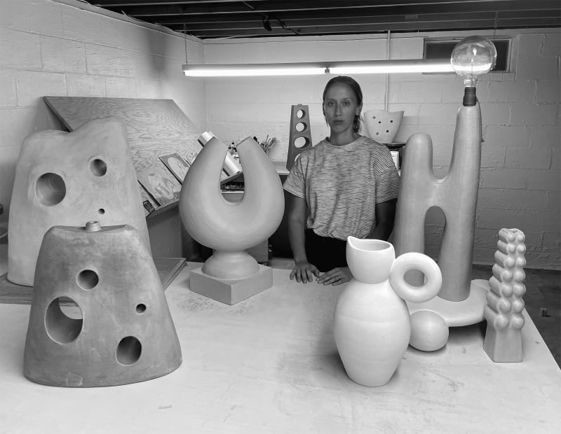 The artist in her studio with CAVE objects