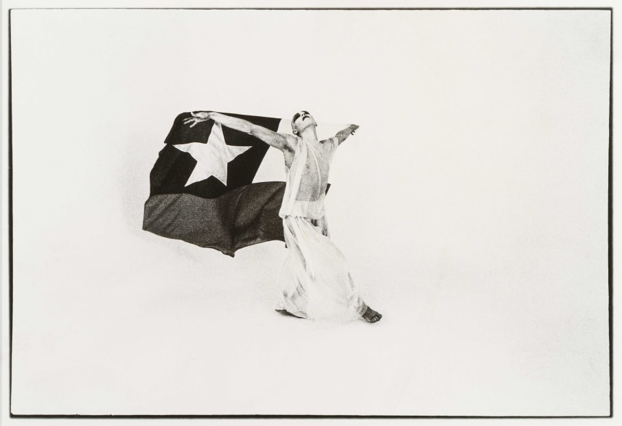 El Mimo y La Bandera (The Mime and the Flag), 1975, Silver gelatin print, 16 x 22.5 cm, Photograph by Giovanna dal Magro