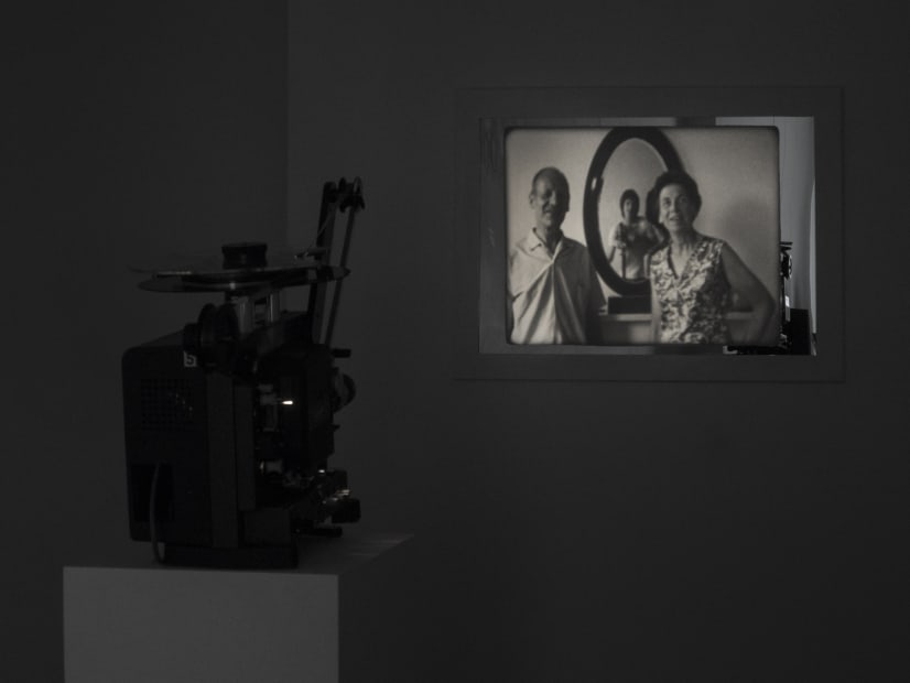 Guy Sherwin Portrait with Parents #2, 2016 (1975) Installation for 16mm projector, mirror, paint, 3 minute film loop (GSN004)
