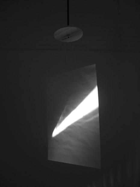 Guy Sherwin Clock Screen #2, 2015 (2007) Installation for 16mm projector, mirror, clock, paper screen, 2 minute film loop (GSN006)