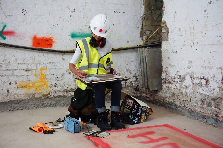 RWS artist Julia Midgley drawing on location at the Whitcomb Street renovation site, 2018