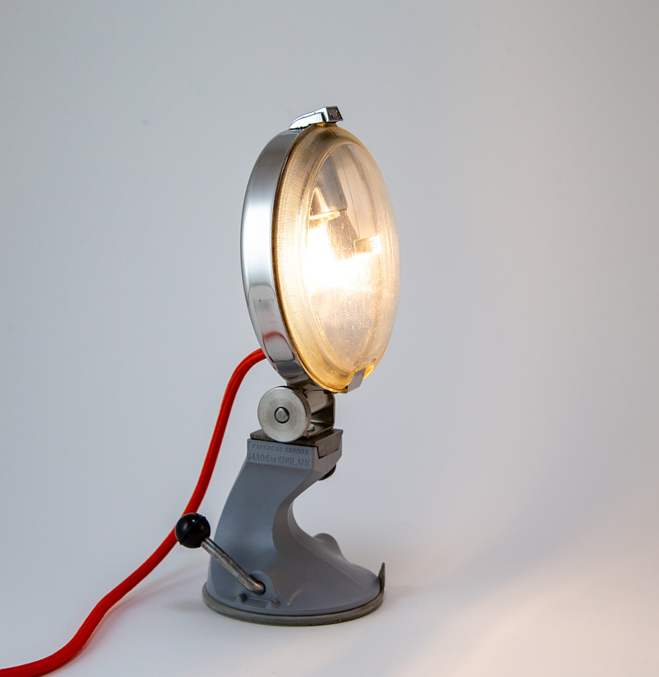 Upcycled vintage Ford Escort headlight table lamp on mid century kitchen appliance base
