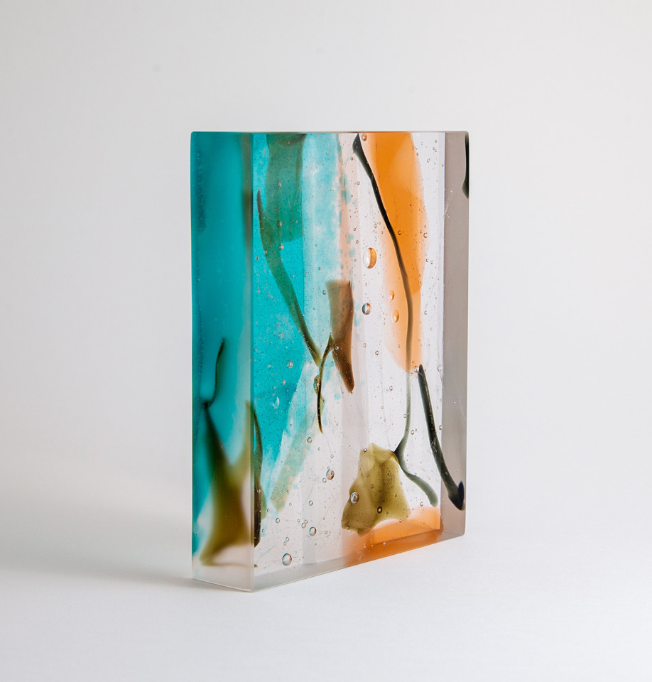 Glass sculpture in cast bullseye glass exploring abstract line and mark making within glass, predominantly jade green and rust.