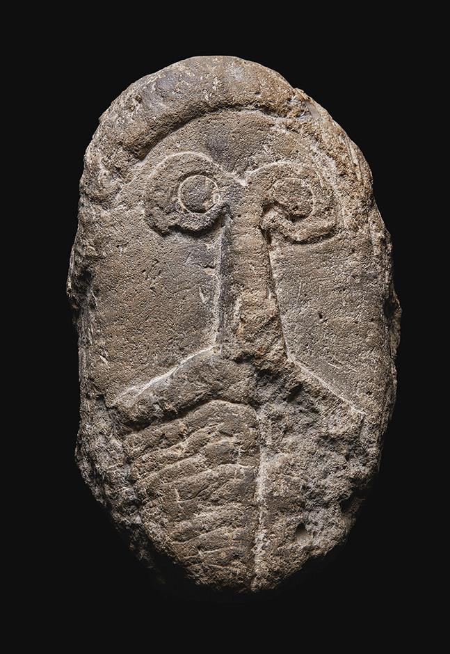 A Celtic Limestone Head of a Man circa 1st Century A.D Stone 32 x 19 cm private collection