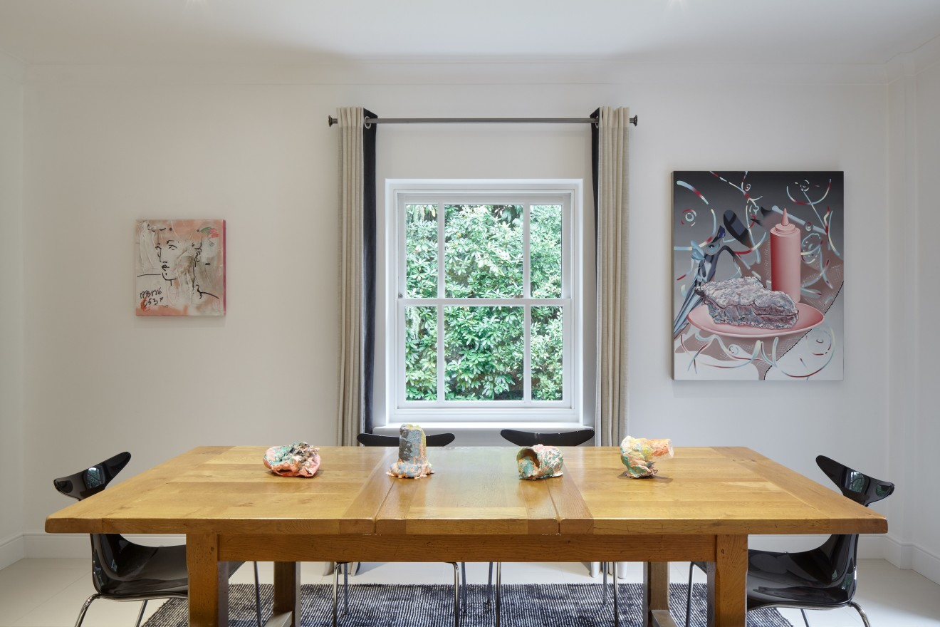 Left to right: Painting by France-Lise McGurn, sculptures on table by Rosie Reed and painting by Jane Hayes Greenwood.