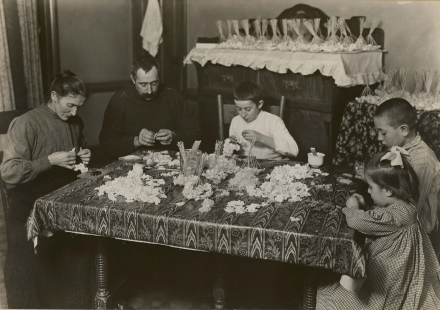Family making paper flowers, 1905