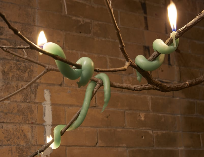 Akashi sculpture, candle and branch
