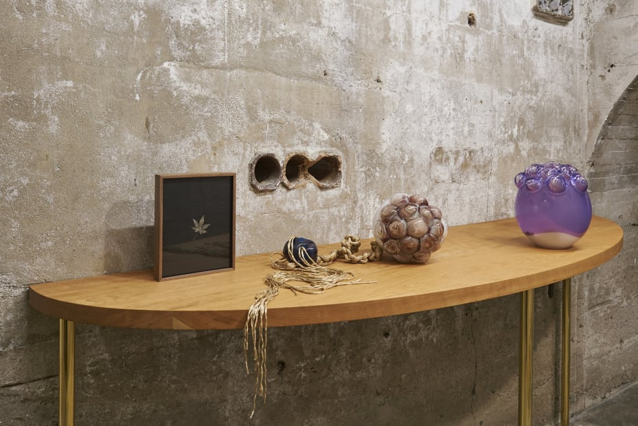 Akashi sculpture, glass objects on table