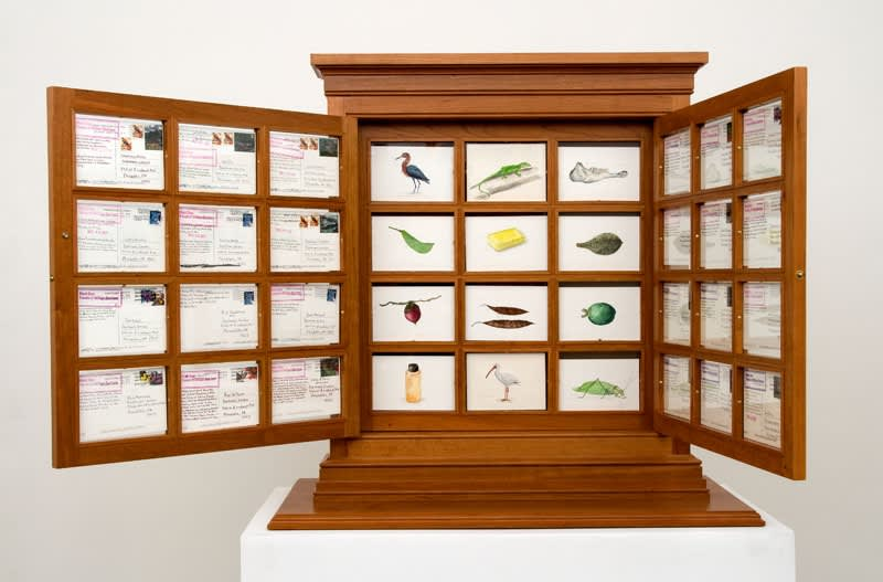cabinet with postcards