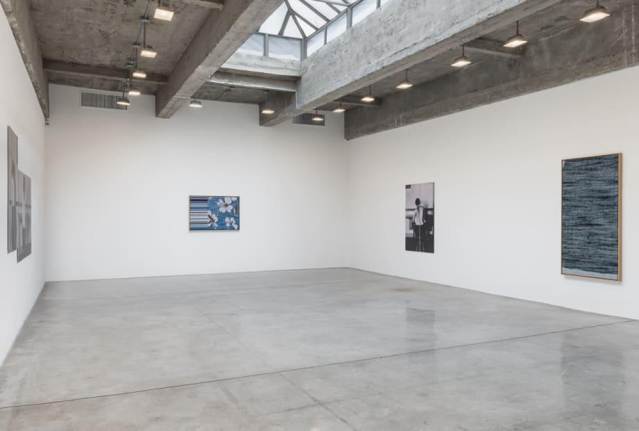 Lisa Oppenheim installation view, women working photographs