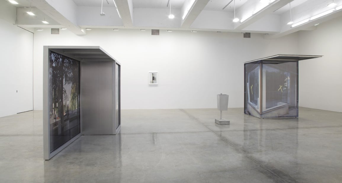 image of Hornig sculptures with transparent photographs