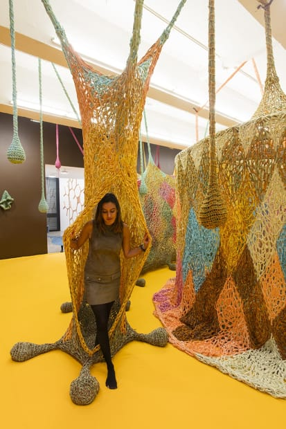 Crochet installation at TBG person coming through