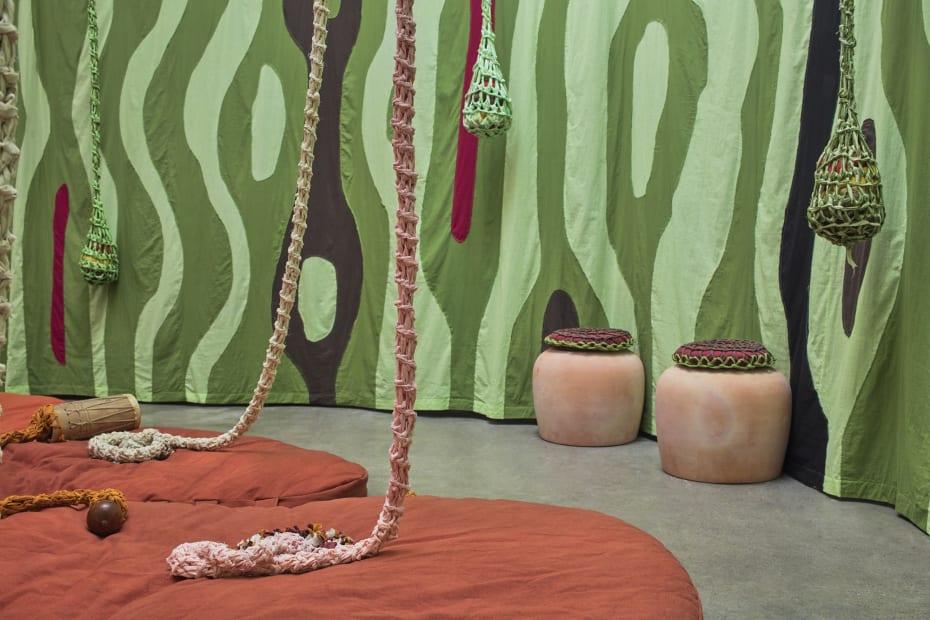 Ernesto Neto installation with instruments, hanging crochet
