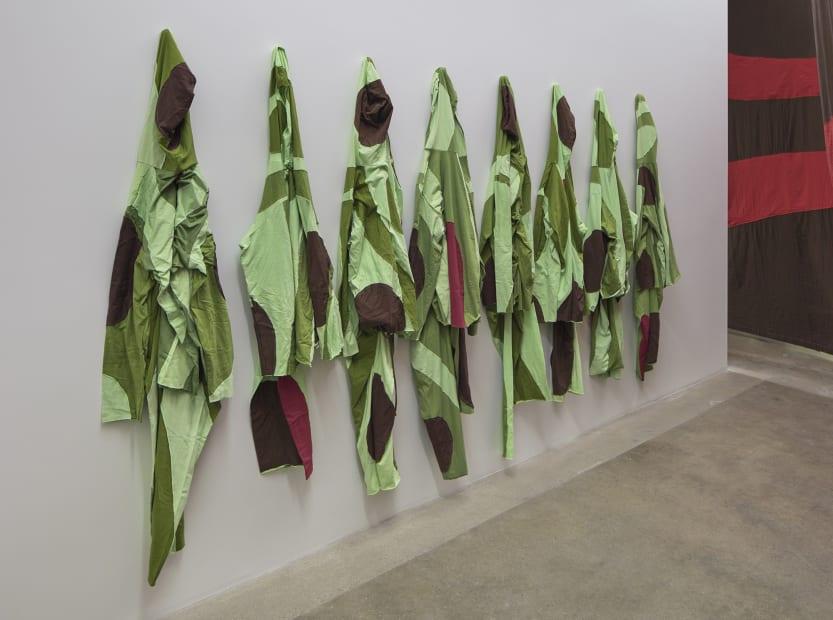 Ernesto Neto installation with instruments, hanging crochet, jumpsuits
