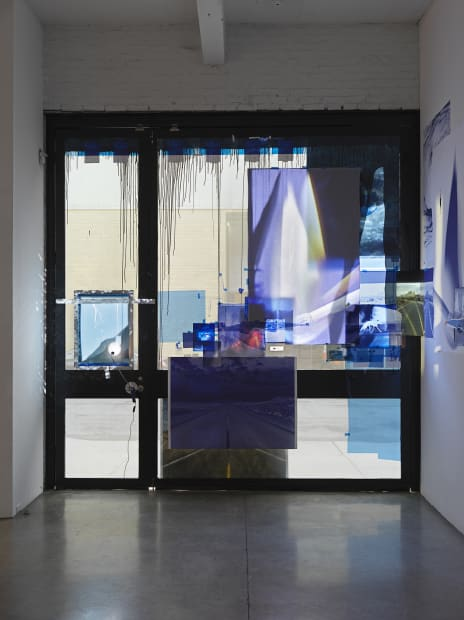 Sarah Sze, installation view of video projections in window