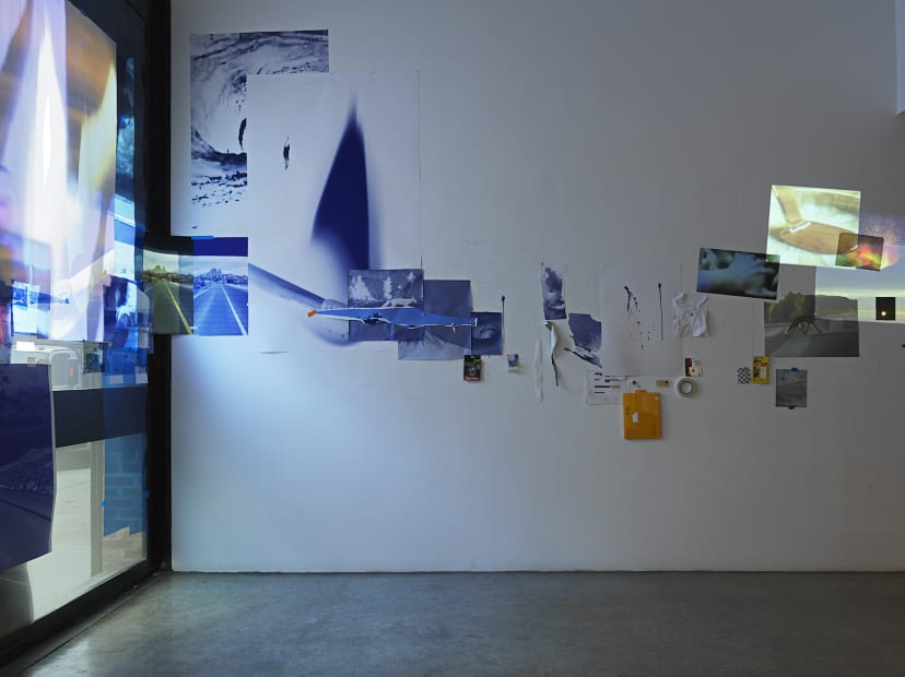 Sarah Sze, installation view of video projections and images on wall