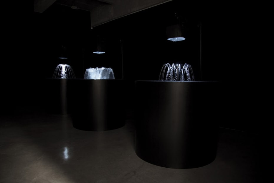 "image of Eliasson ""volcanos"" made of water and light flashing"