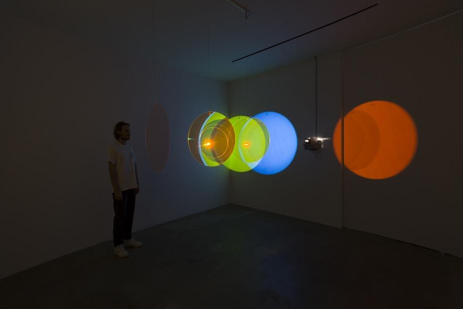 image of eliasson, lens flare installation in dark room