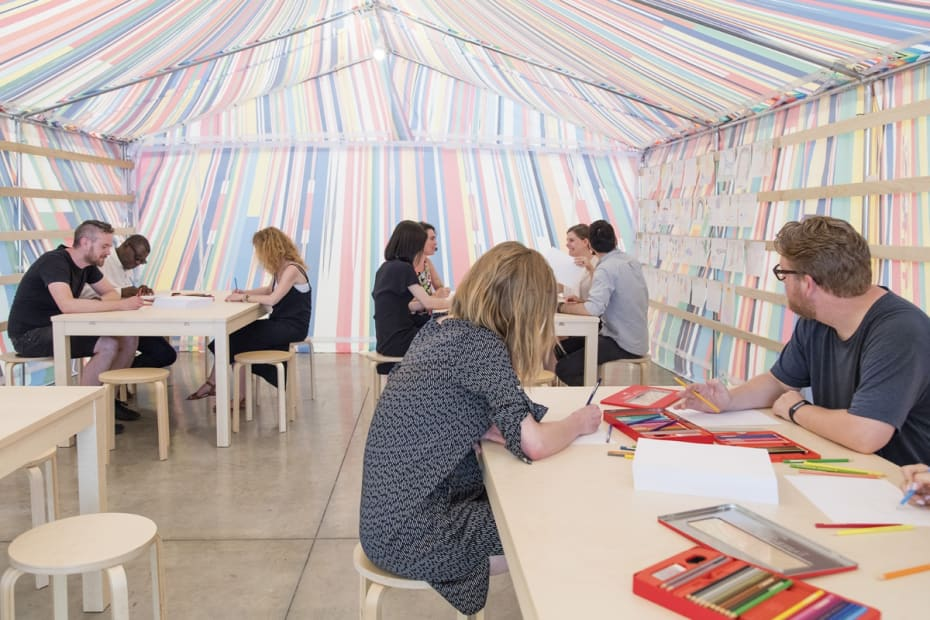 image of a Meschac Gaba tent with tables and drawing material inside