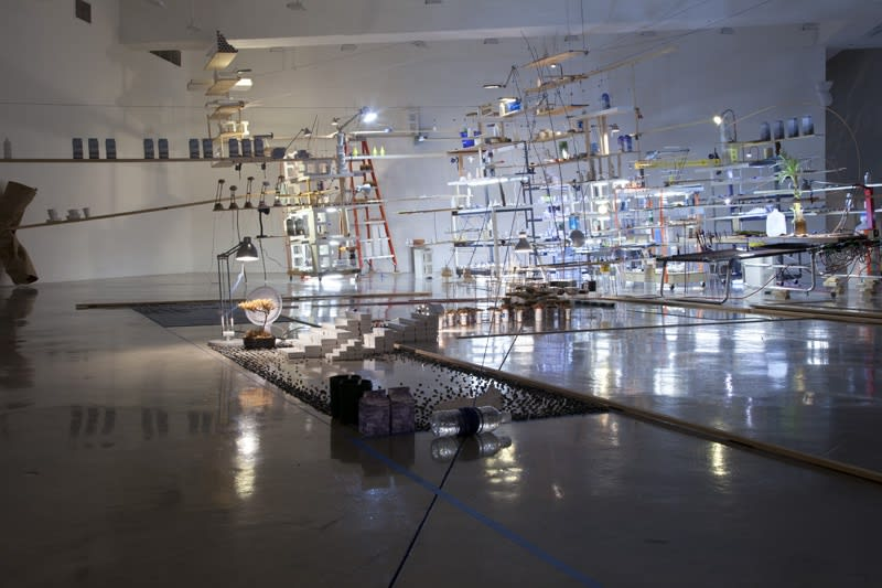 sarah sze installation view of large structure with dimmed lights